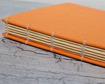 Small Orange Coptic Journal