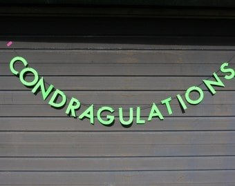 CONDRAGULATIONS congratulations RuPaul's Drag Race inspired letter banner - paper garland in neon green