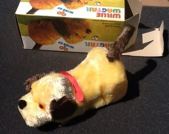 1960's dime store mechanical windup dog willie wagtail.