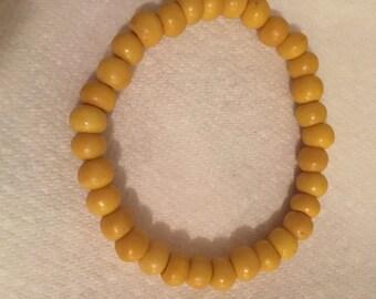 Yellow wooden beaded bracelet