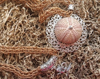 A red Sea Urchin Necklace.