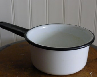 White enamel handled pot