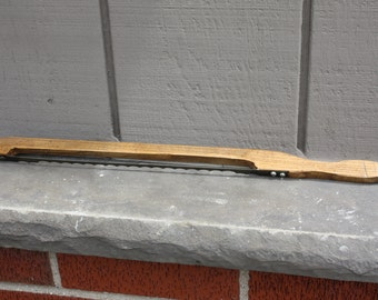 Vintage handmade wooden Fiddle bow bread slicer knife.