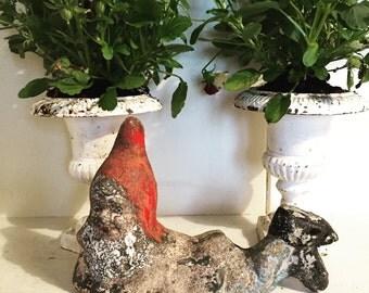 A vintage mini garden gnome