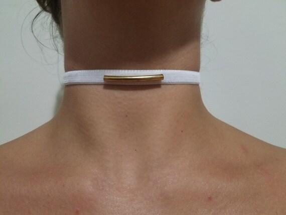 White velvet with gold colored bar adjustable choker