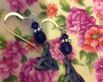 Dark purple and sterling silver pierced earrings with Trinity knot charms.
