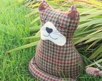 Alfred, a snoozy cat doorstop.  Cat bookend.  Made from pure new wool.