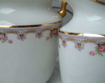 Antique French Limoges porcelain creamer and sugar set with lavender, pink and gold detail. Tiny pink roses. Shabby cottage chic.