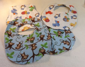 baby bib, newborn bib, and burp cloth made from jungle monkeys flannel w/ baby toy flannel backing making it reversible