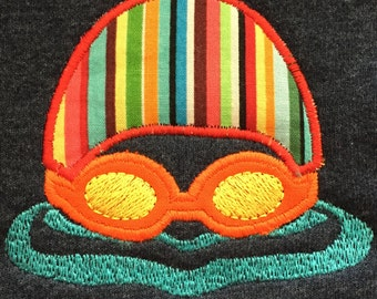 Swimmer with swim cap and goggles machine embroidery and appliqué designs in several sizes and styles.  Perfect for swim team gear.