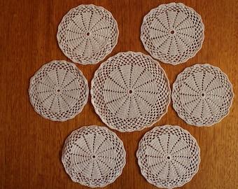 Set of seven doilies
