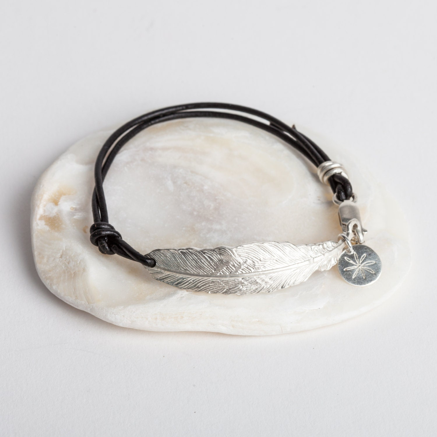 feather bracelet on soft leather with silver clasp