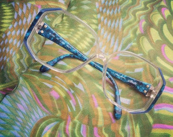 FREE SHIPPING on this fabulous 1980's pair of Silhouette eyeglasses, clear frame with shades of blue.