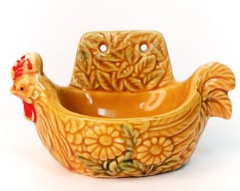 Soap dish in a rooster shape. in yellow mustard color with sunflower pattern