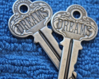 "Silver Toned Key ""DREAMS"""