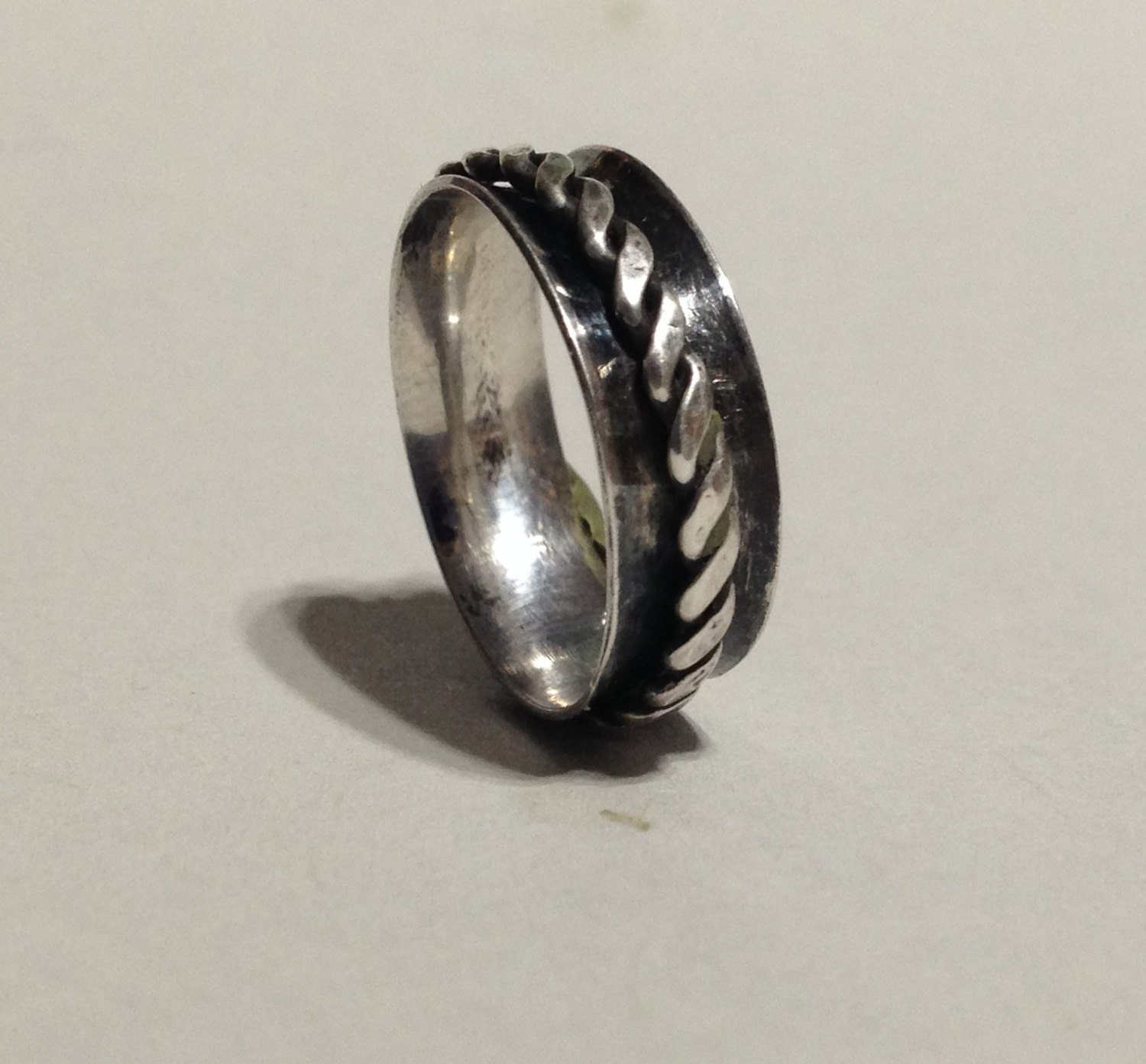 Spinning Ring in Silver and Copper Narrow Spinner Ring Turning
