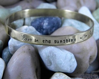 Emerson Quote Live In The Sunshine Swim The Sea Drink The Wild Air Gold Bangle