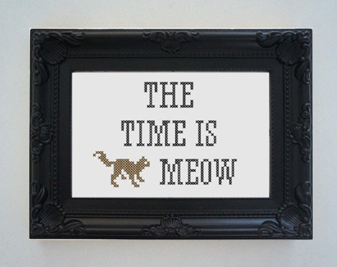 Framed 'The time is meow' cross stitch
