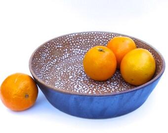 Handmade black ceramic bowl with white textured inner surface