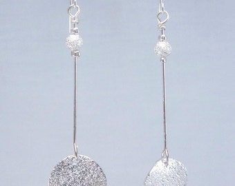 Moonshine earrings featuring silverplated stardust disk and bead on headpin with hypoallergenic silverplate earring hooks