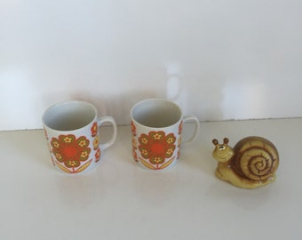 Pair of Flower Power Orange and Green Mugs from the Seventies