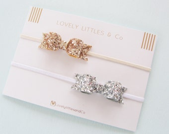 Girl/Baby Gorgeous Gold and Silver non-shedding Glitter hair bow on skinny elastic headband.