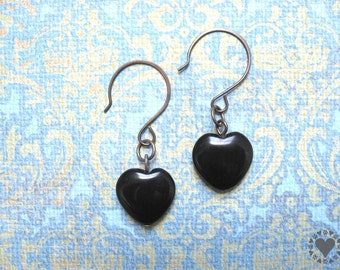 Athena - antiqued brass tone earrings, jet black ceramic heart bead - All donated to animal charity
