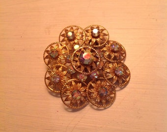 Vintage Flower Pin, Goldtone with faceted rhinestones, Excellent condition
