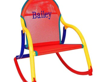 Personalized childrens rocking chair with red mesh (outdoor furniture) fabric that folds and is 100% watersafe -for use wherever kids want.