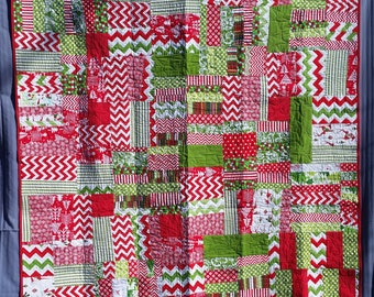 Christmas scrappy lap-sized quilt. Handmade. One of a kind.