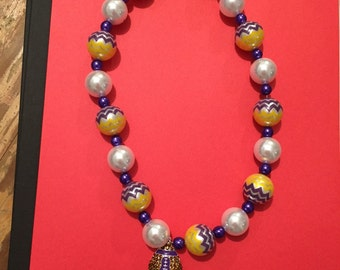 Purple and gold football necklace