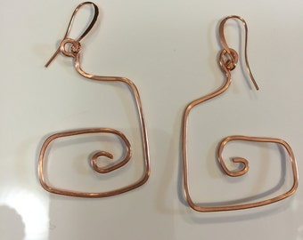 Copper curled and hammered wire earrings made into a large square spiral on Copper french hook earwires.