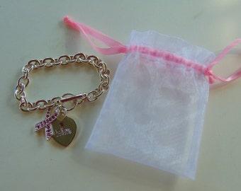 BELIEVE Breast Cancer Bracelet by Carson Pirie Scott