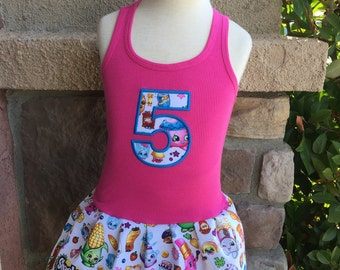 Custom made dress with licensed character fabric. Shopkins.