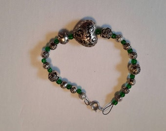 Green and silver beaded bracelet.