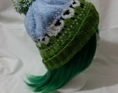 Hand knitted hat with adorable sheep in the field pattern and pompom by Liz