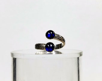 The ring is adjustable from size 8------10 it has 2--- 6 mm stones in it