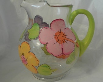 Hand painted round pitcher in fun soft hibiscus. 66 ounces.