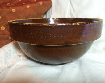 Vintage Red Wing stoneware bowl that is marked on the bottom RWSC .