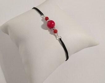 Adjustable bracelet, red coral, black silk cord