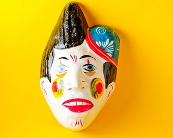 Traditional Mexican paper mache mask clown