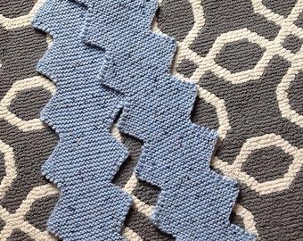 Hand knit zigzag scarf in blue tweed.