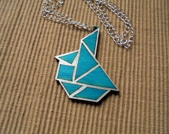 Necklace, tangram, sailboat (683)