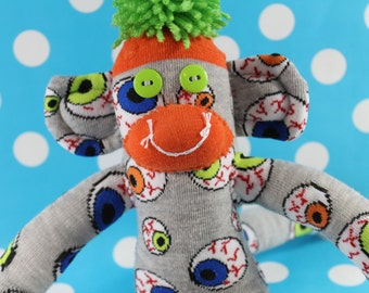 Sock Monkey / Bloodshot Eyeball / Halloween / Grey, Orange, Green, Blue / Halloween Decoration / Unique Gift / Gifts for Him / Gifts for Her