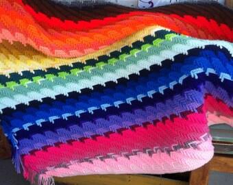 Handwoven rainbow colored throw