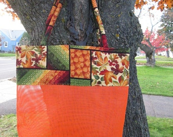 vinyl mesh tote bag, vibrant fall colors,funky design, lightweight, shoulder handles,quality made