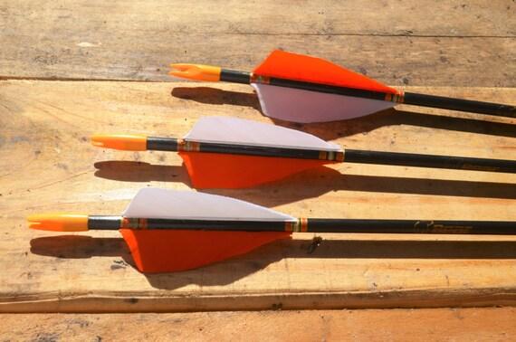 Archery arrows, 3 vintage Bear fiberglass arrows. black with orange and white
