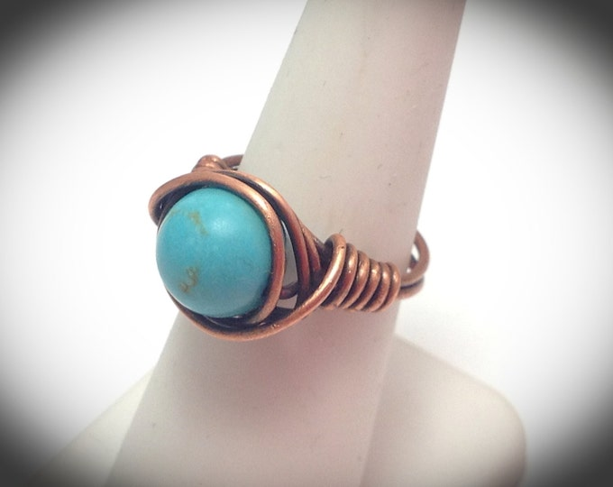 Genuine turquoise wire wrapped copper ring