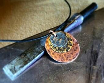 Multimetal layered pendant