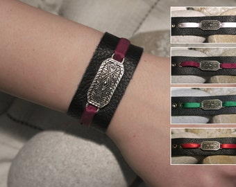 Leather bracelets / wristbands with Pewter center piece and coloured ribbon.
